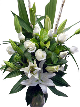 glass vase with classical roses and white oriental lilies