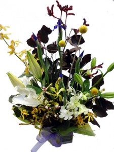 Flower Arrangement of liles, orchids and dash of seasonal blue