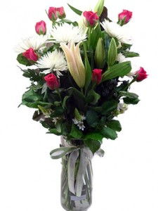 Oriental lilies, roses and chrysanthemum in a glass vase