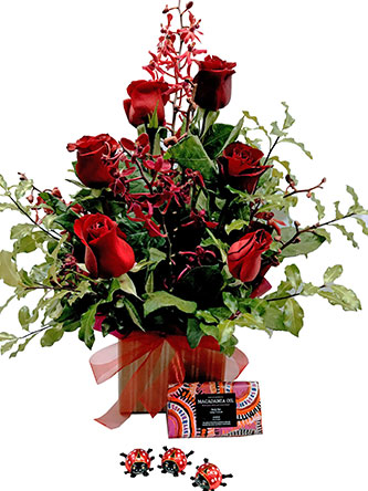 Red Roses and orchid arrangmenet